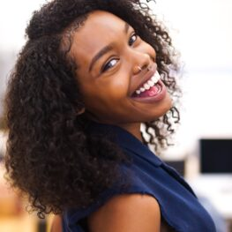 A Woman Smiling with Healthy Teeth